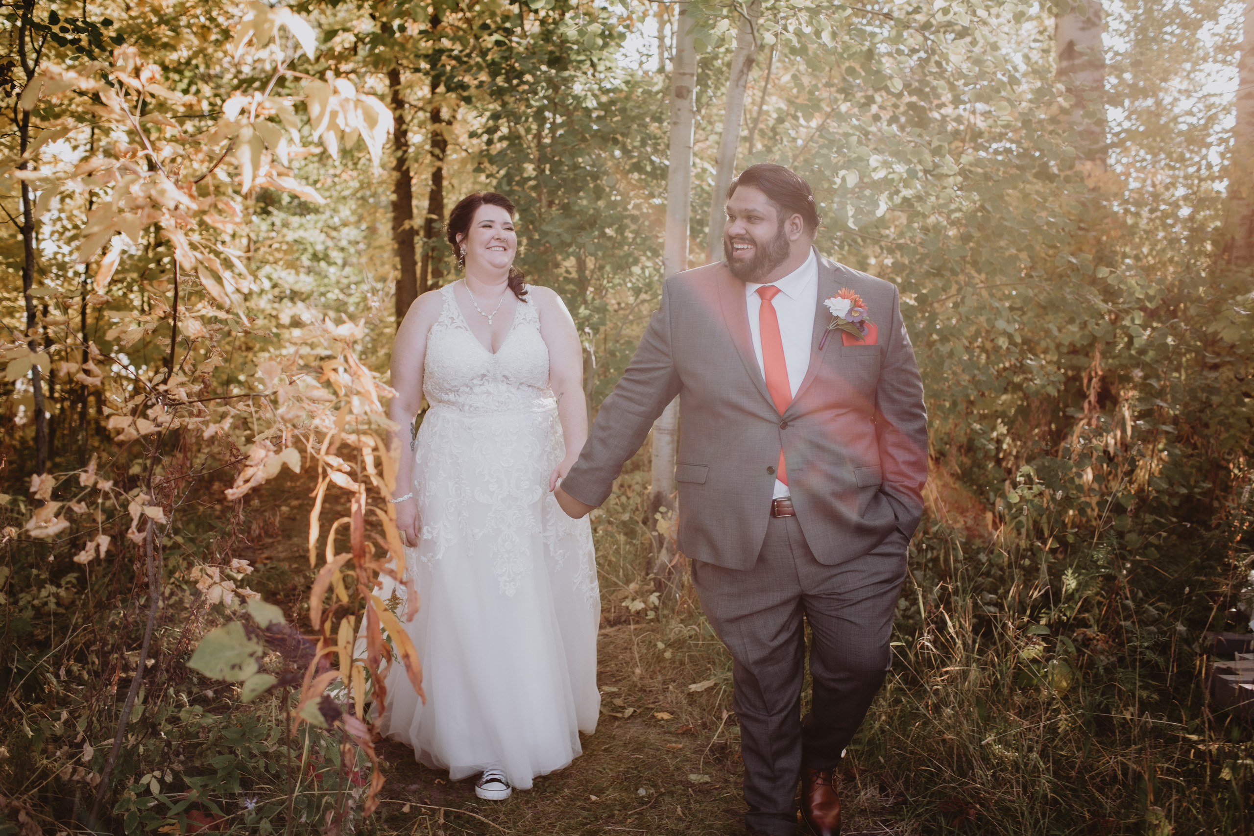 Wedding Couple Walks in Forest