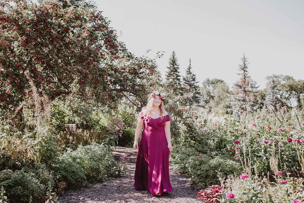 Winnipeg grad walks through English Gardens during photoshoot.