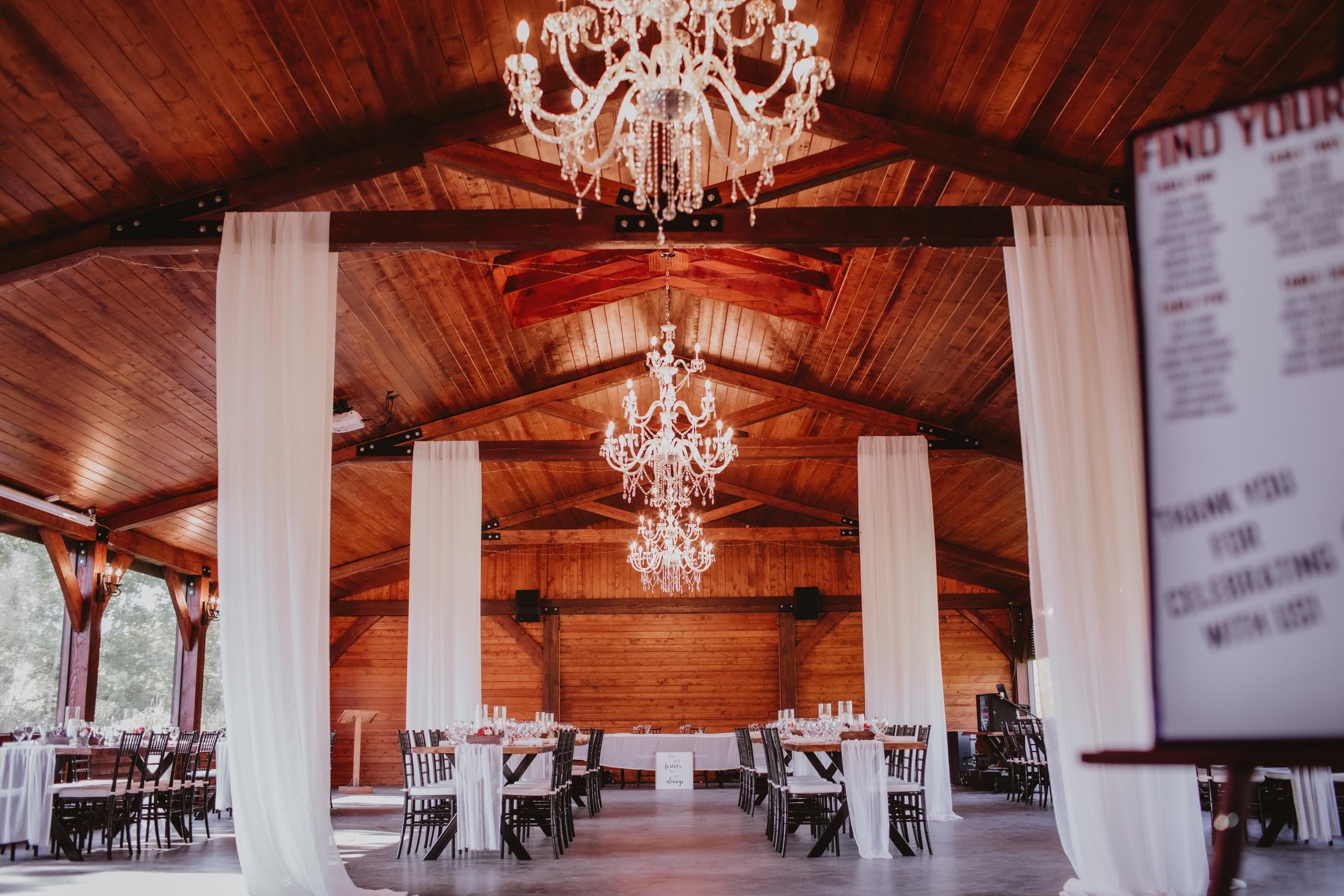 Stunning Chandeliers in Manitoba wedding venue - Rivers Edge Resort.