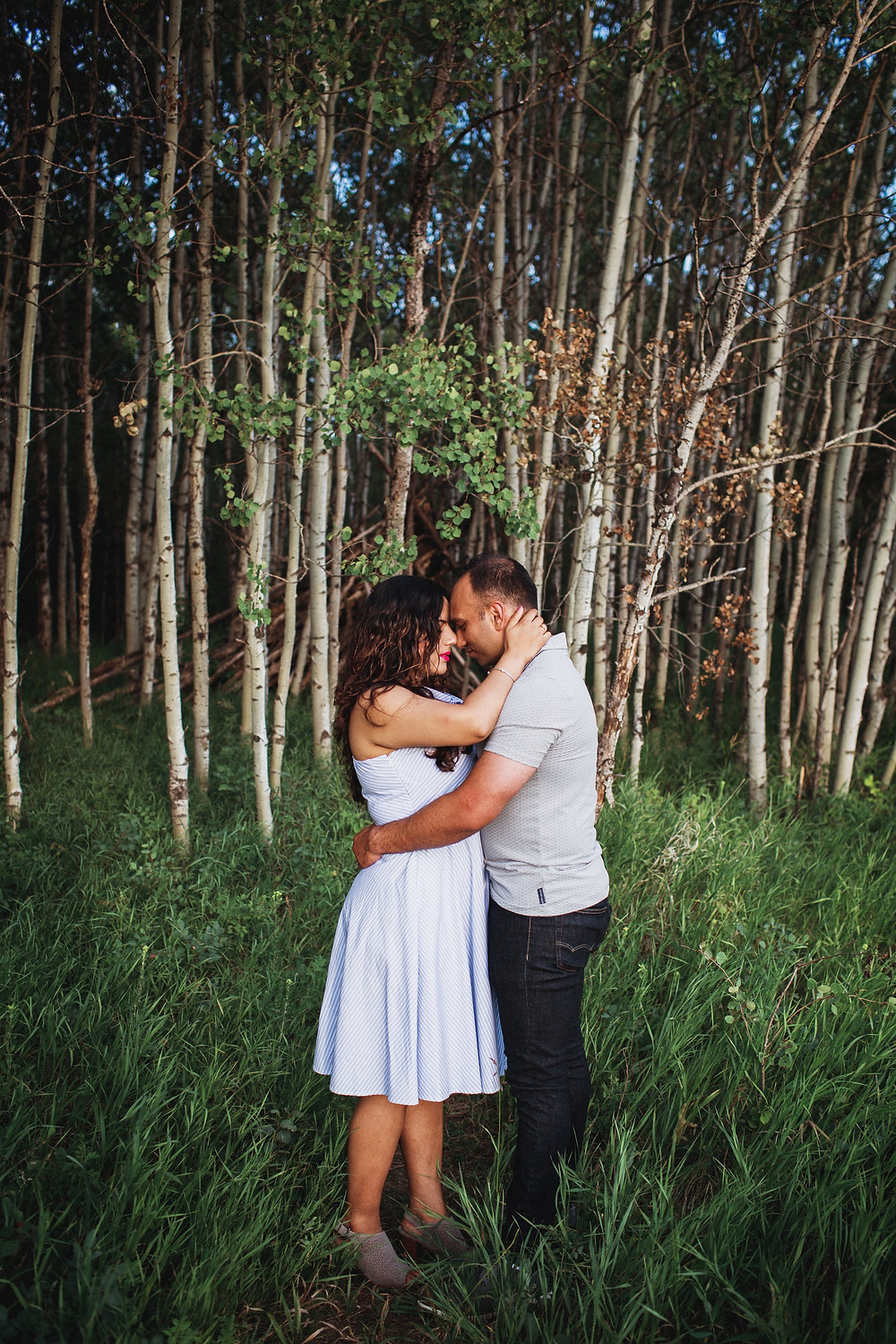 Forest love story session featuring newly engaged couple.