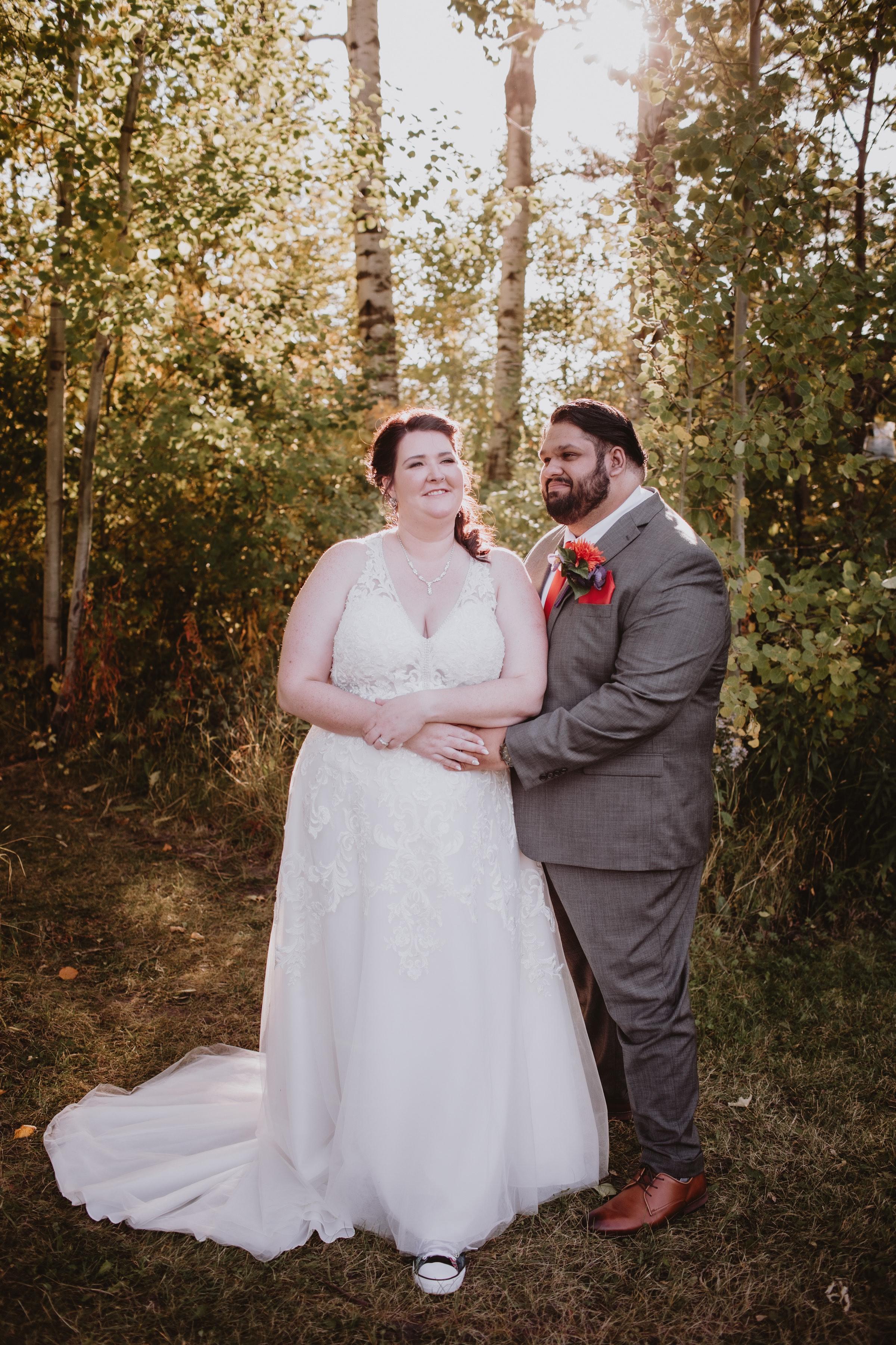 Smiling Wedding Couple poses for wedding portrait in Elma, Manitoba.