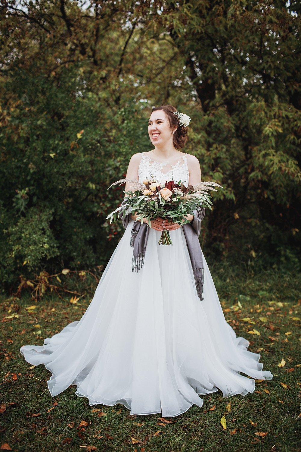 Smiling bride during her rainy fall wedding