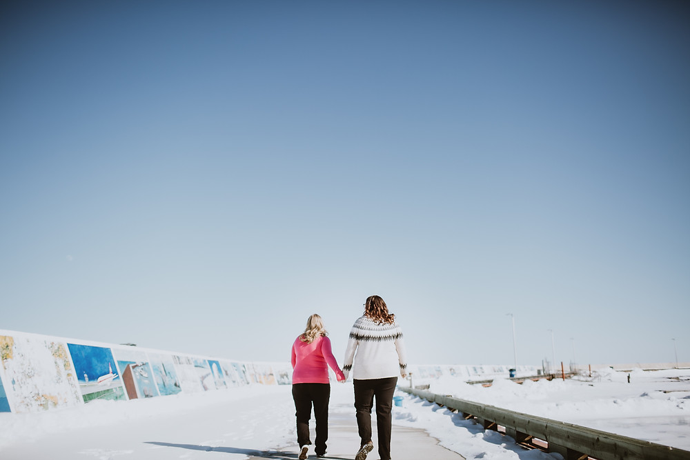 Sunny winter engagement session at the Gimli pier.