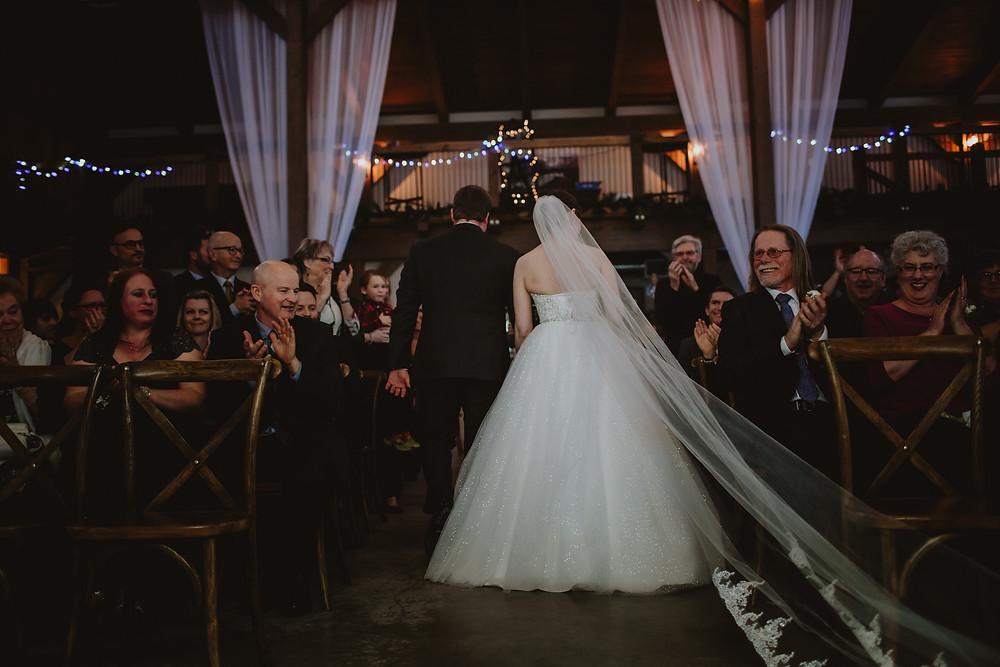 Bride and groom exit wedding ceremony.