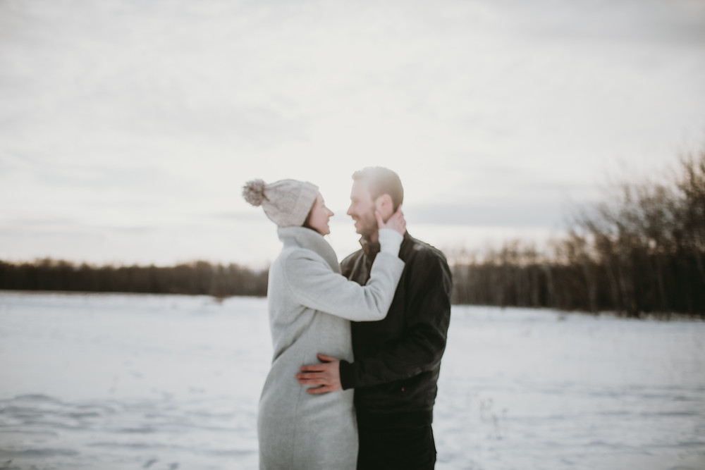 Prairie winter engagement session with couple not in focus.