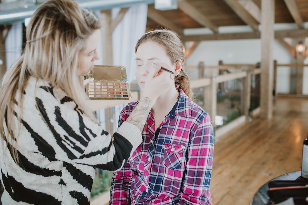 Bride gets her makeup done by Nikki Markoski.