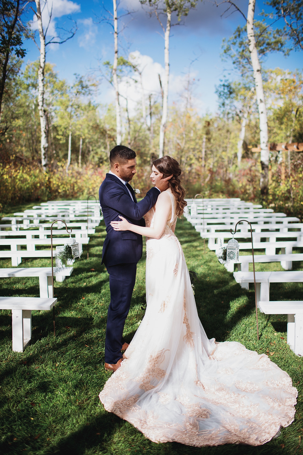 Manitoba wedding venue in the Interlake, Kinloch Grove. Bridal gown by Anna Lang Bridal. Suit by Eph Apparels.