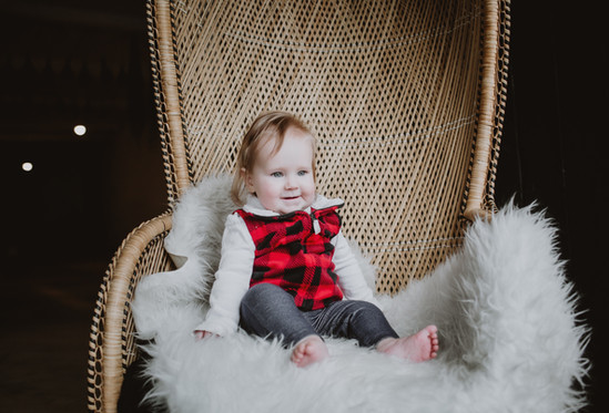 Little Girl Poses on Giant Wicker Chair