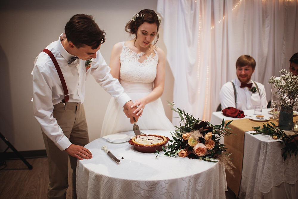 Bride and groom cut pie instead of cake for their wedding.