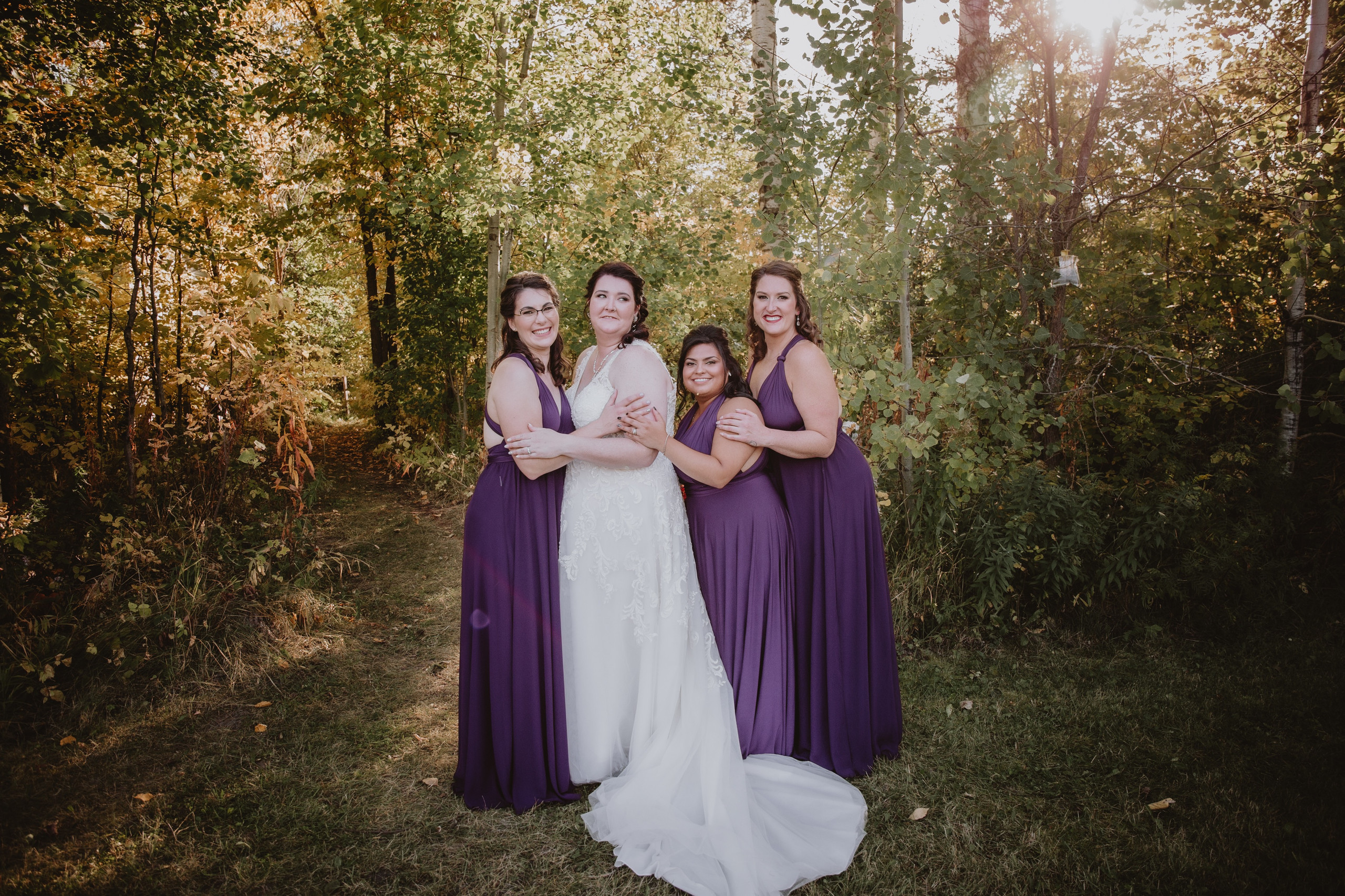 Bride and Bridesmaid pose for a portrait.