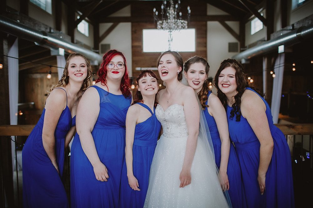 Bride with her bridesmaids for indoor portraits.