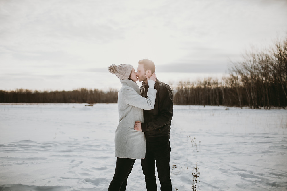 Sunset kiss during Winnipeg, winter engagement session.
