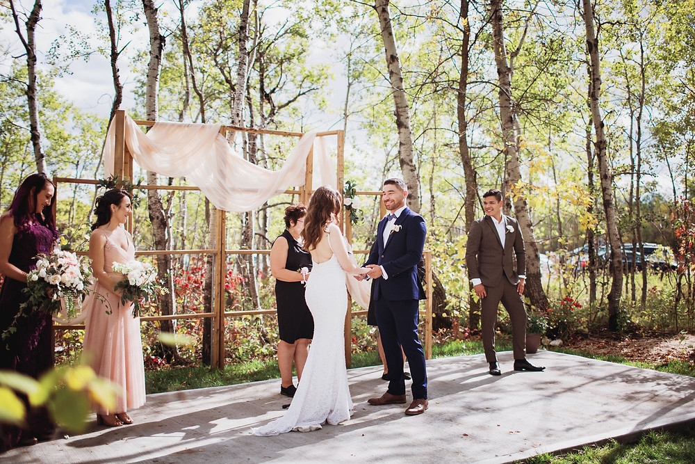 Wedding ceremony at Kinloch Grove, in Matlock, Manitoba.
