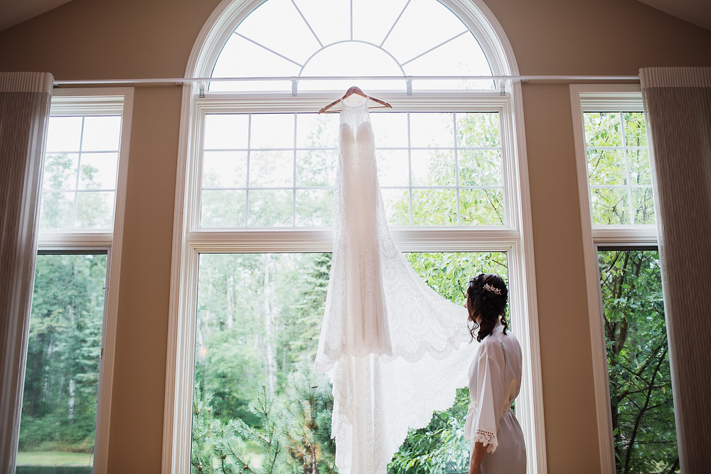Bride with her lace wedding gown by Wilderly from :LA Collections