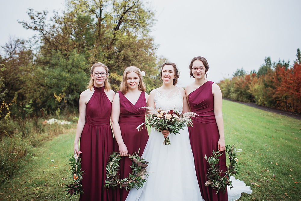 Fall bridal party during rainy wedding day.