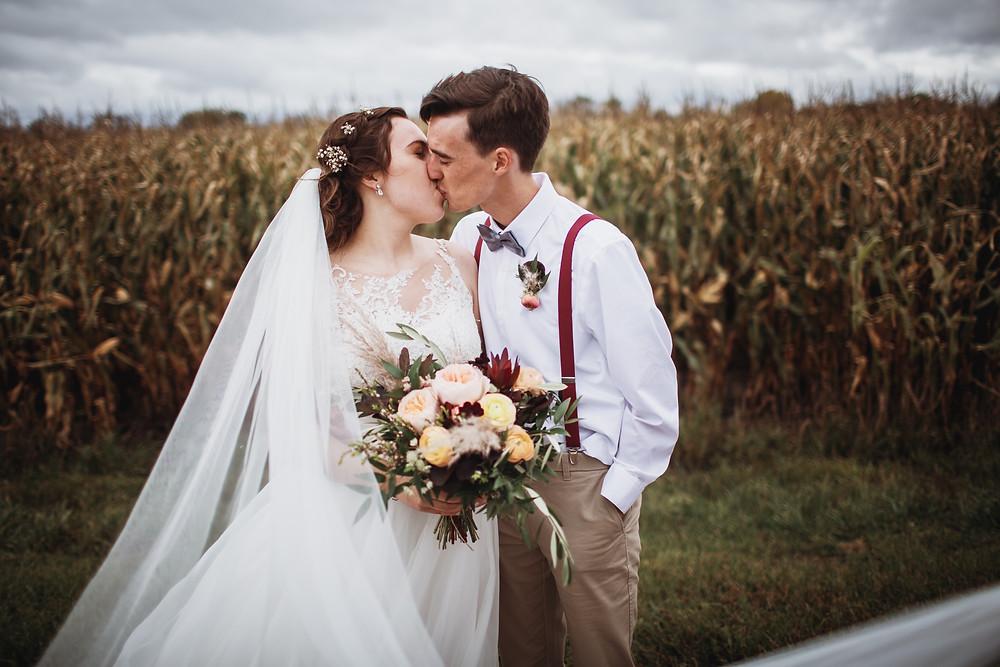 Winkler bride and groom kiss post wedding ceremony.