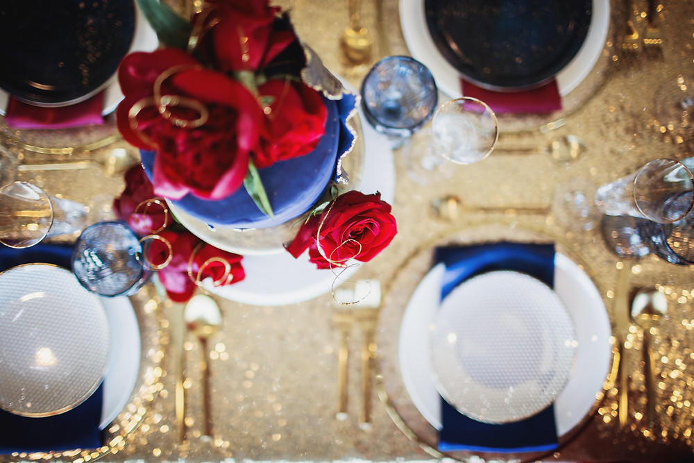 Tablescape inspired by the Marvel cinematic universe and featuring a wedding cake by Roll Cake Bakery.