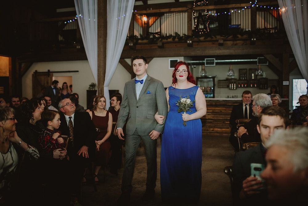 Bridesmaid in royal blue and groomsman in grey.