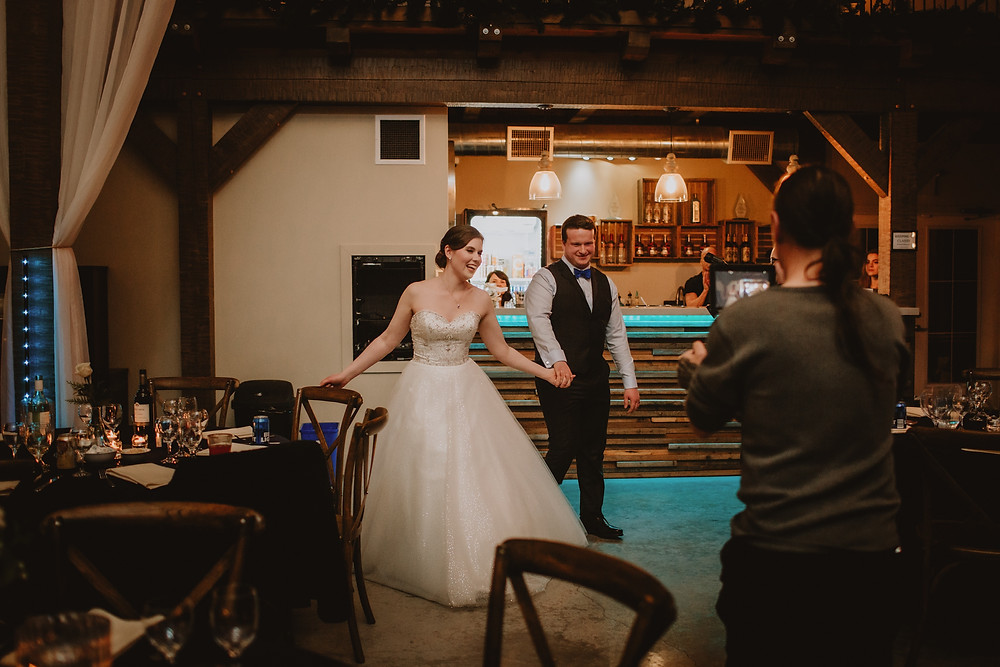 Wedding couple enters wedding reception at Hawthorne Estates.