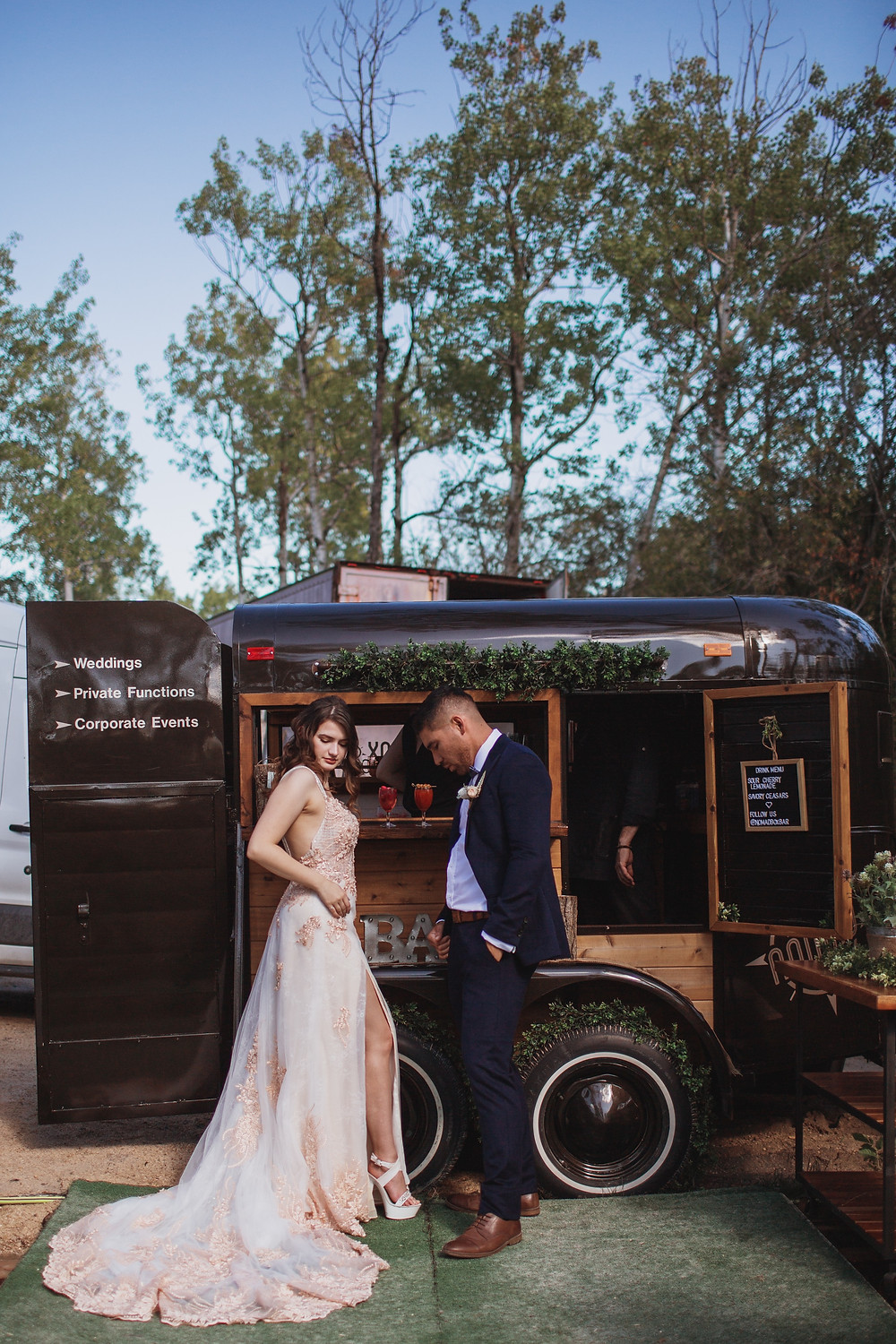Bride and groom by mobile bar, Nomad Box Bar
