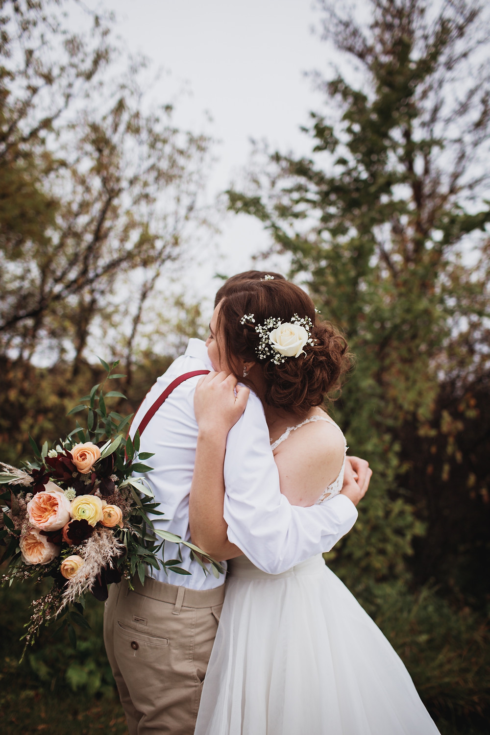 Bride and groom embrace.