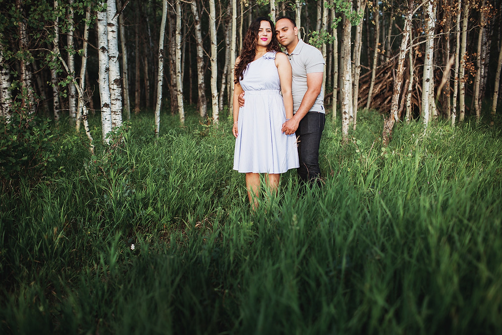 Canadian engagement session in Winnipeg forest in July.