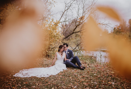 Fall Bride and Groom Cuddle in Foliage