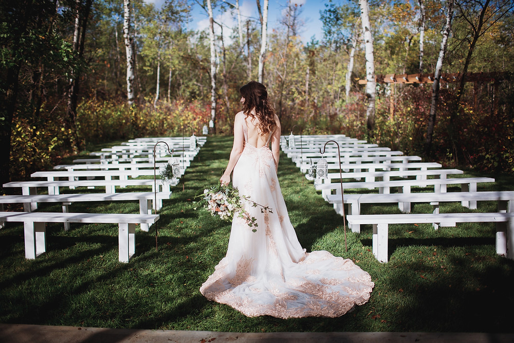 Bridal gown by Anna Lang Bridal, bouquet by Yellowbirch Florals, Venue Kinloch Grove.