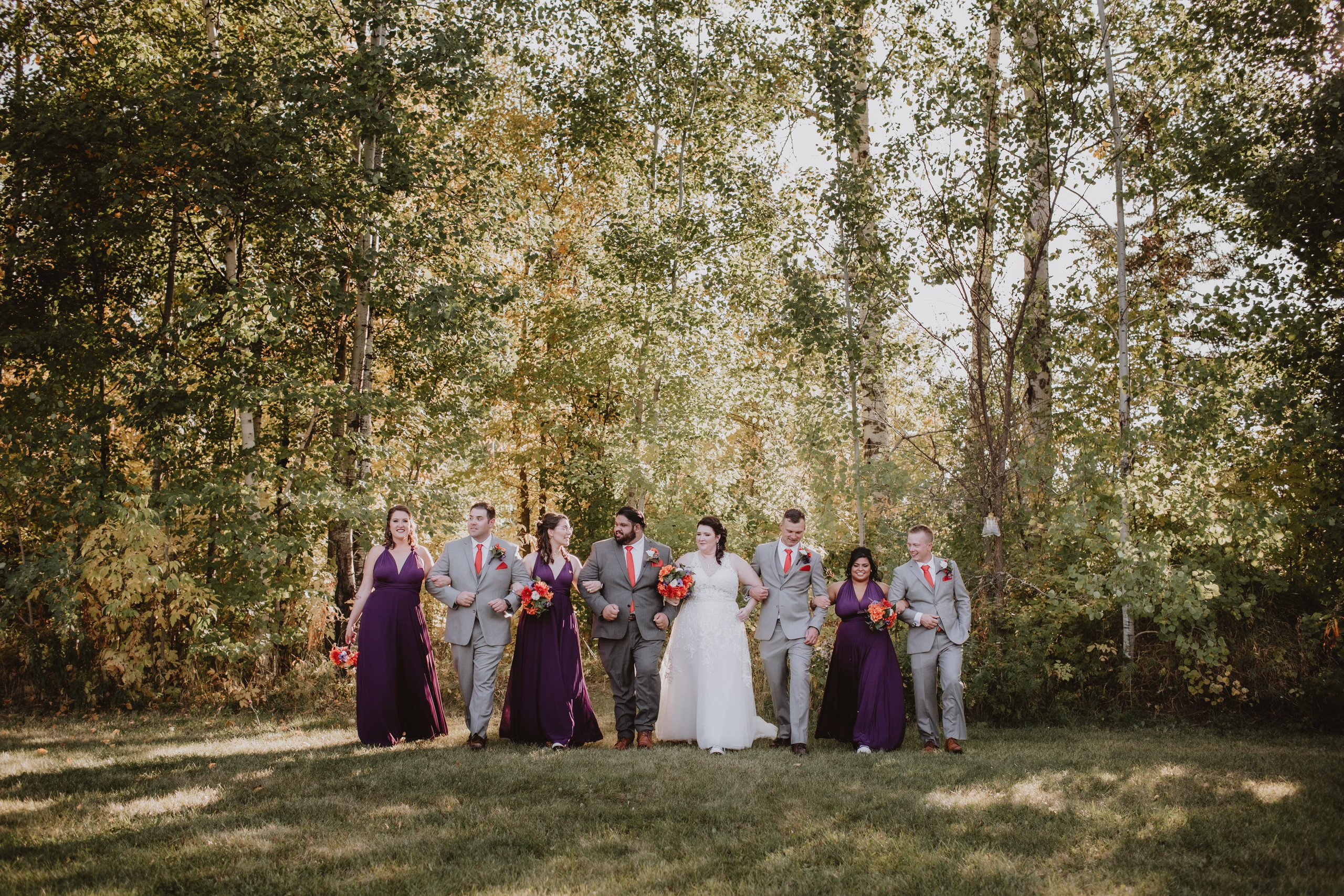 Bridal Party Links Arms and walk during bridal party portraits