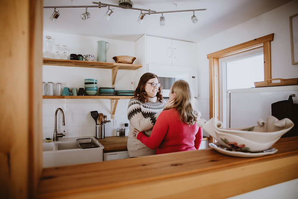 In-home engagement photo session, featuring couple in the kitchen.