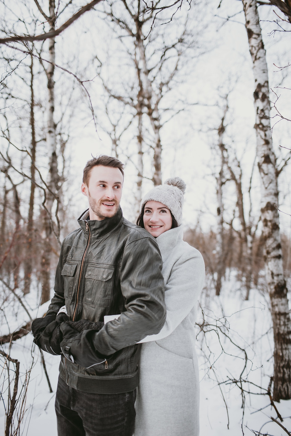 Couple poses during winter engagement session.