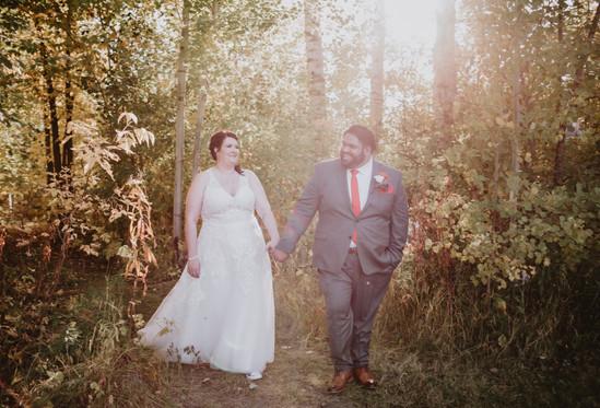 Wedding Couple Walks Holding Hands