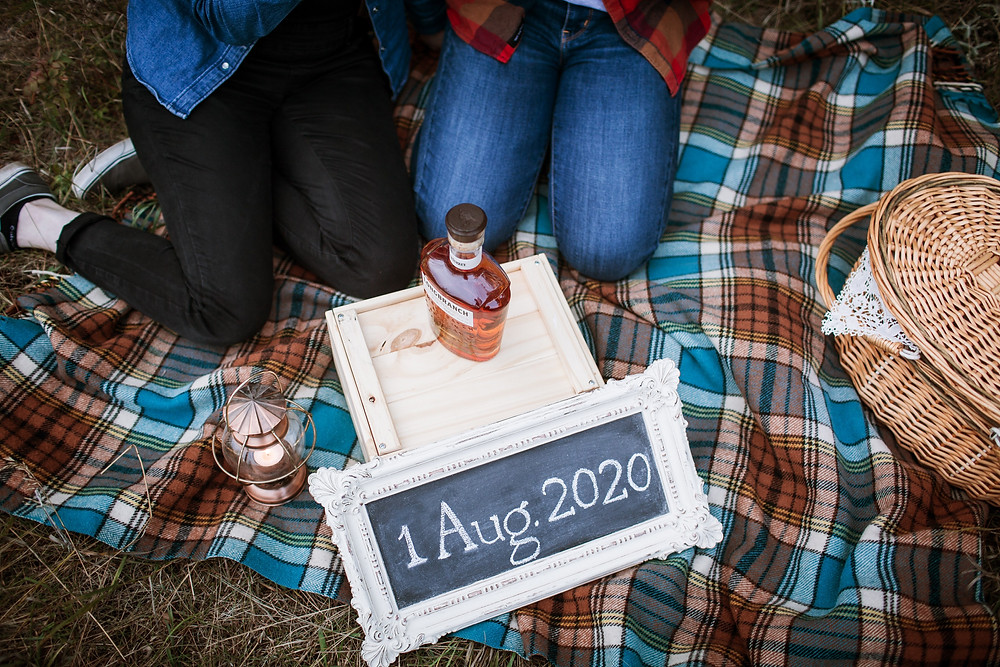 Engagement photos displaying wedding date.