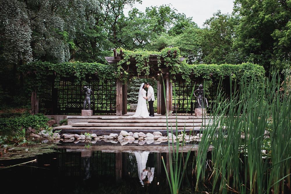 Wedding portraits in the Leo Mol sculpture garden in Assiniboine Park, Winnipeg, Manitoba.