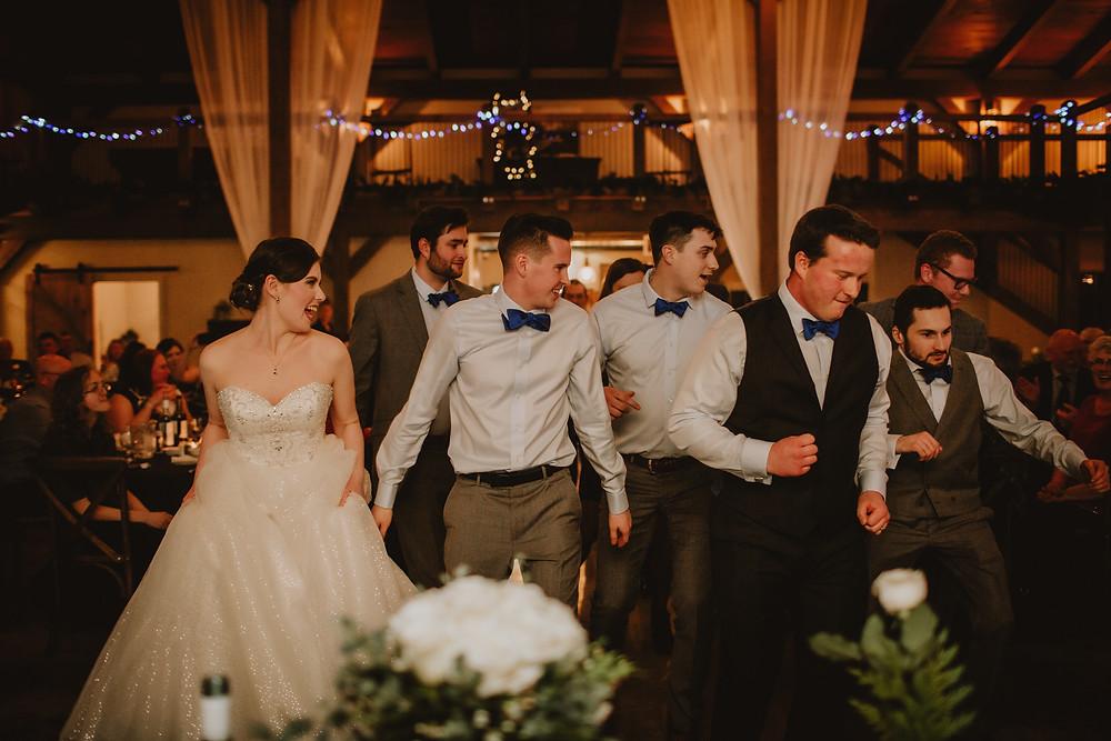 Line dancing during wedding reception at Hawthorne Estates.