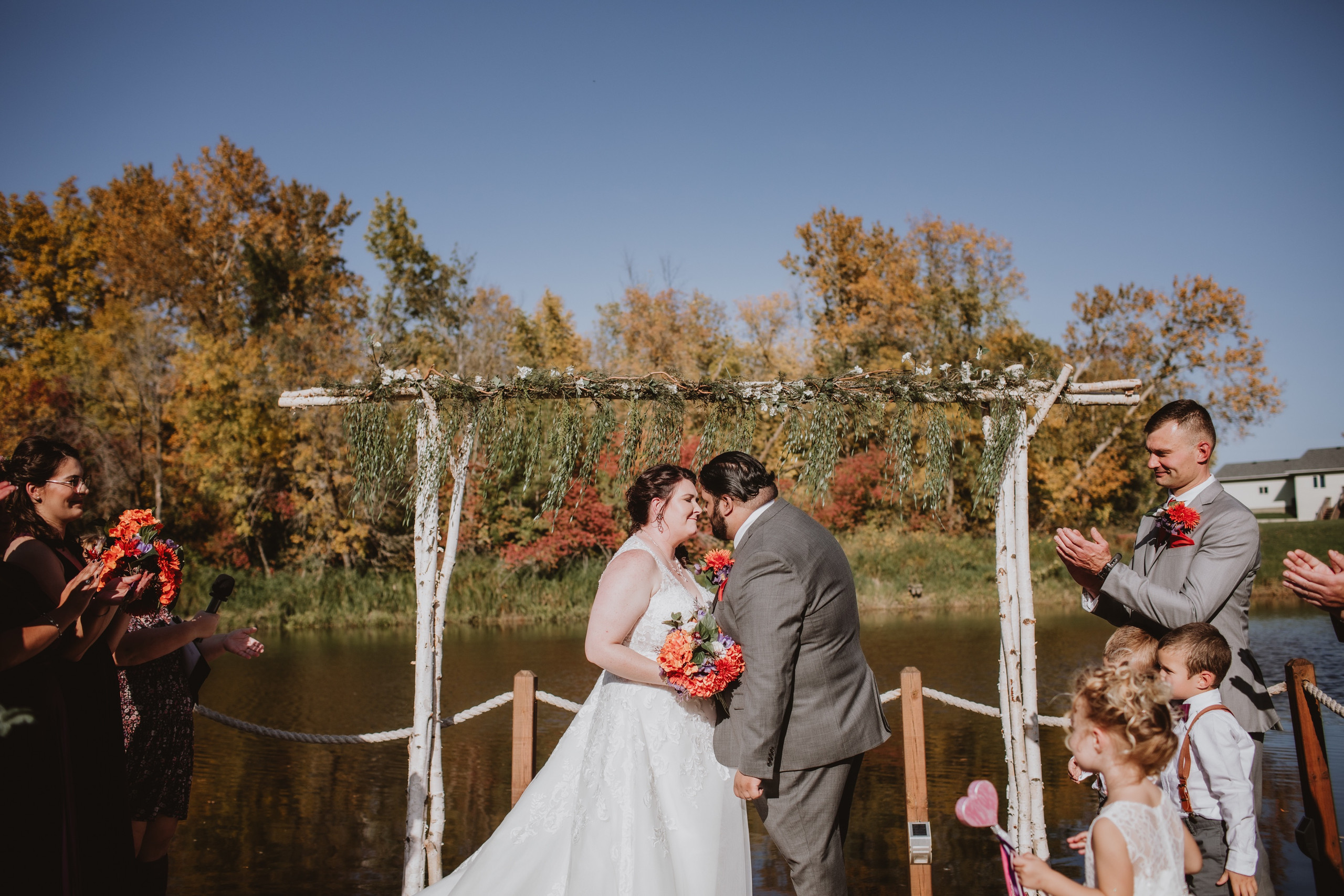 You May No Kiss - Wedding couple seals their union with a kiss during fall wedding ceremony.