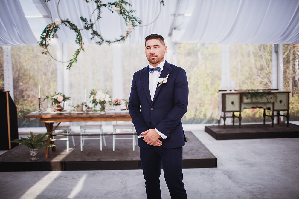 Groom in navy suit by Eph Apparel