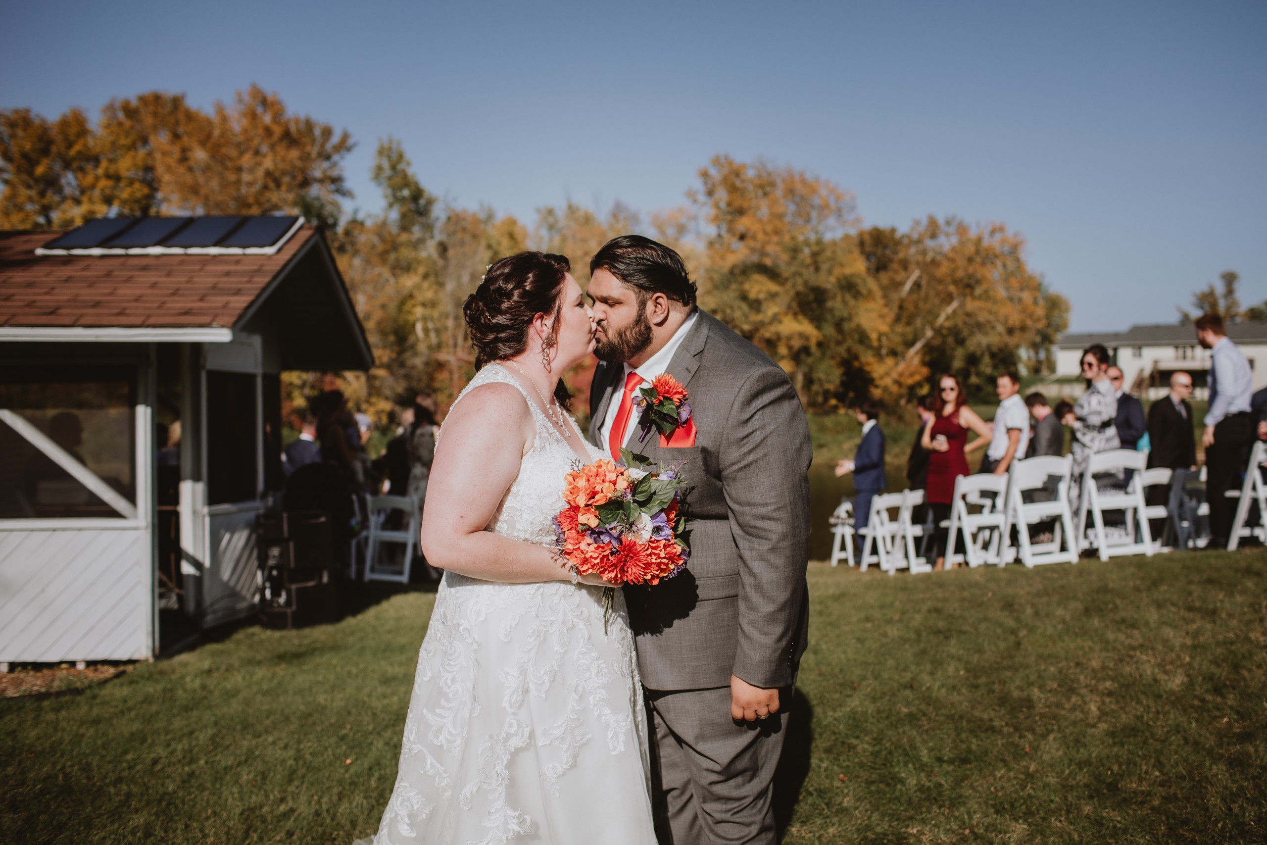 Fall Wedding Kiss at the end of the aisle as couple exits.
