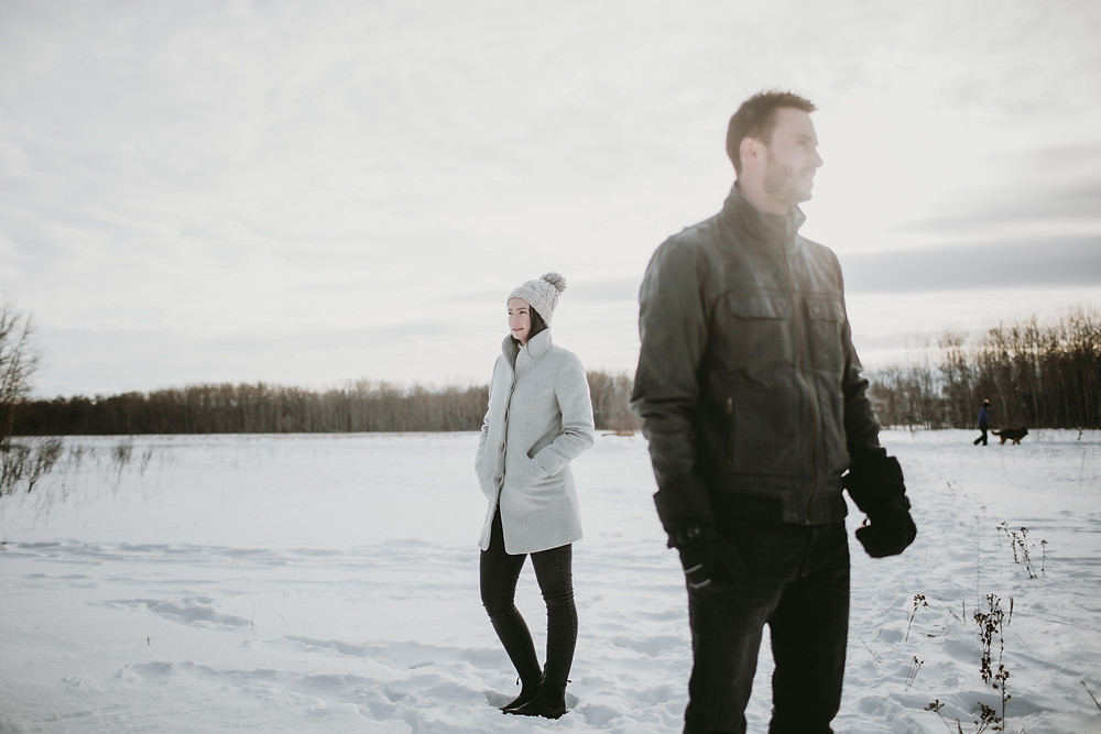 Winter engagement photo session, against a prairie sunset.
