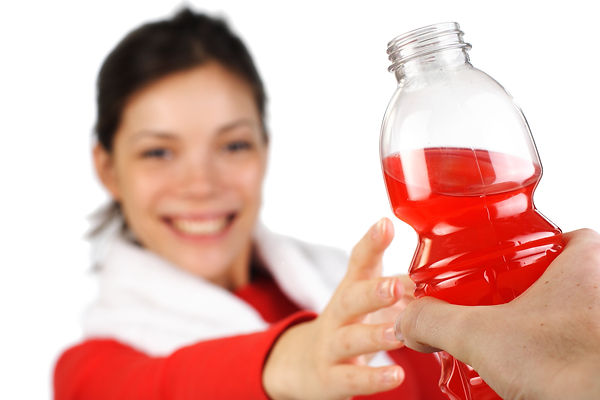 Fitness woman receiving an energy drink