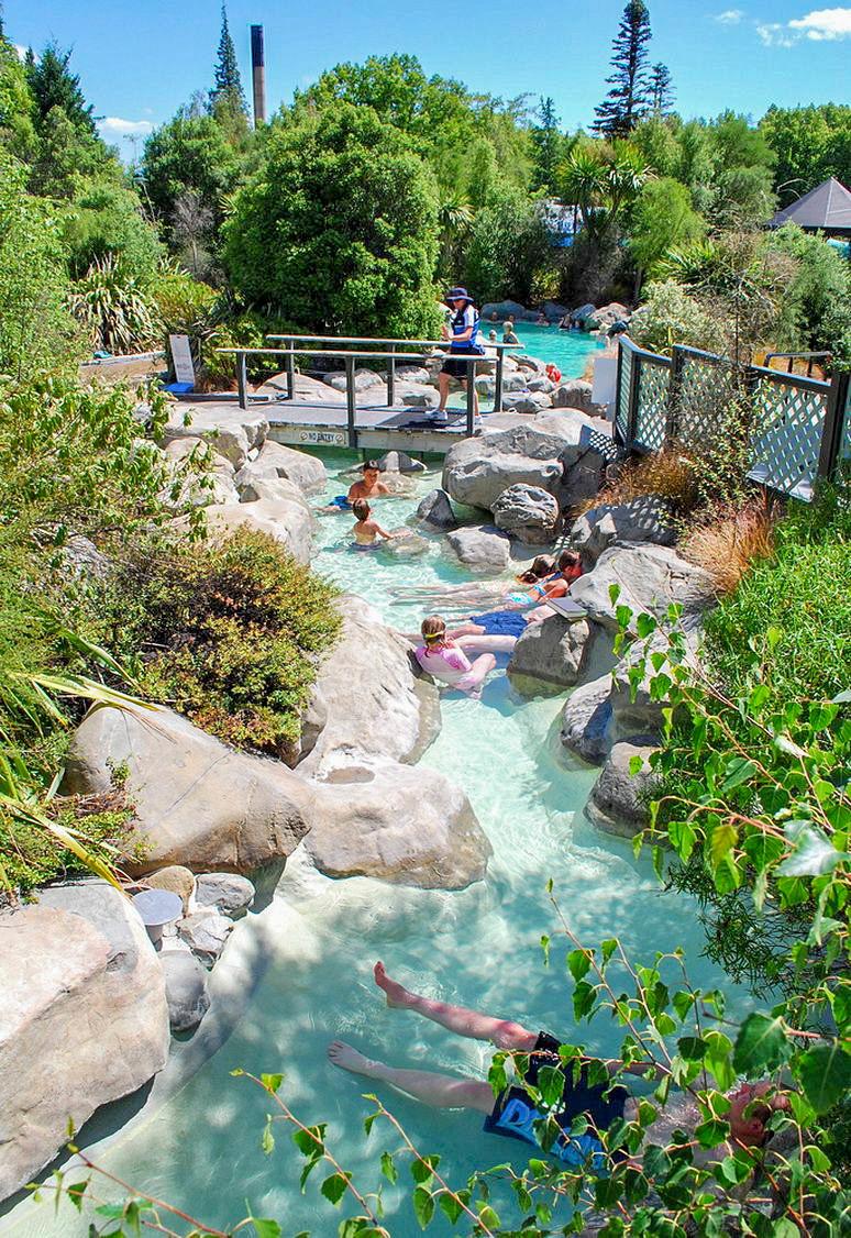Bathers in natural thermal pool landscape design at hanmer springs