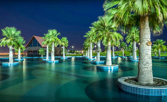 Al Bayt Stadium landscape design including water feature and trees