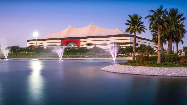Al Bayt Stadium landscape architecture water fountain over lake and island