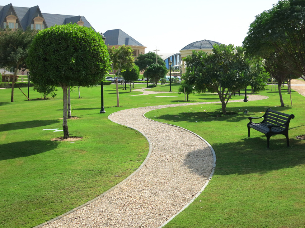 pathway in landscape gardens at grand heritage hotel