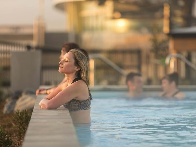 Bather relaxing at the He Puna Taimoana hot pools landscape design, Christchurch