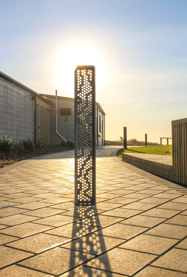 Sunrise over pocket park hardscape design at New Brighton Seafront