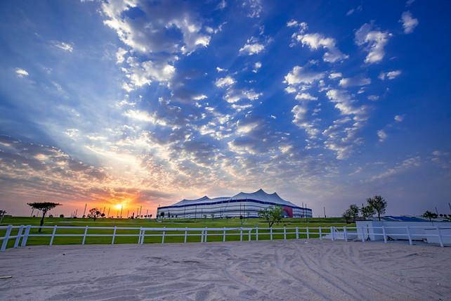 Al Bayt Stadium sunset over horse and camel paddock landscape design