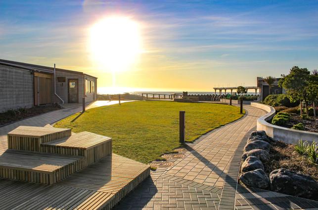 Sunrise over the pocket park landscape design at New Brighton Seafront