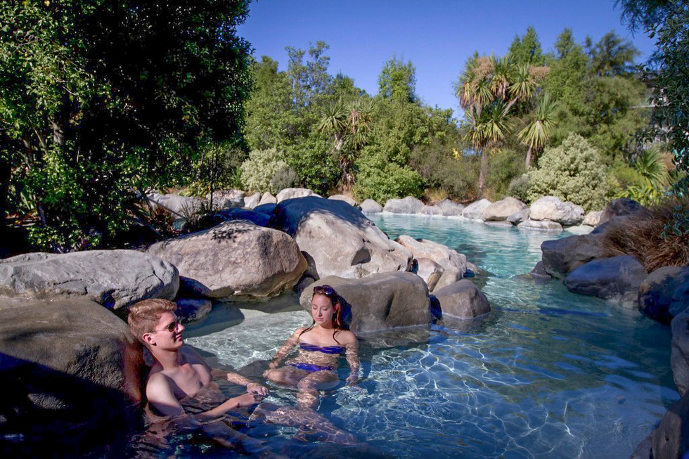 Bathers relaxing in Hanmer Springs natural hot pools landscape design