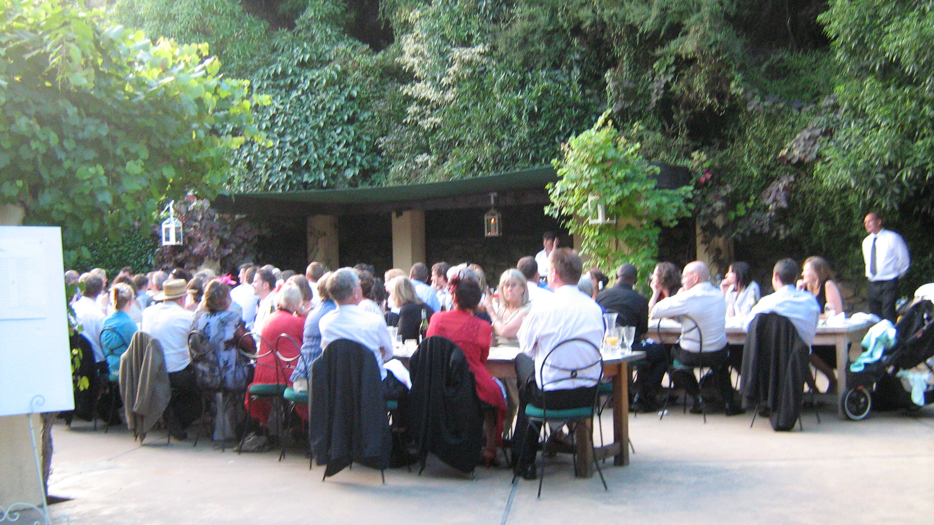 people sitting in courtyard landscape at french farm winery